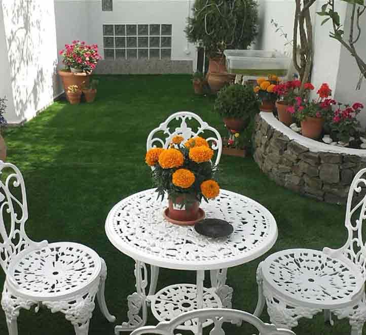 cesped artificial para terraza y ejemplos de instalación